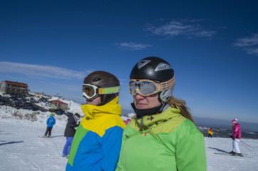 skiers helmets glasses couple man woman Vasilitsa Greece