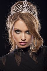 Beautiful young woman posing with a crown on her head