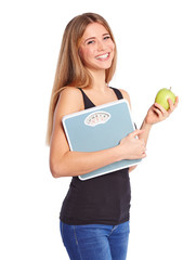 Girl with green apple and personal scale