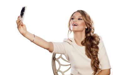 beautiful young woman takes selfie