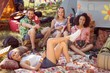 canvas print picture - Happy hipsters relaxing on campsite