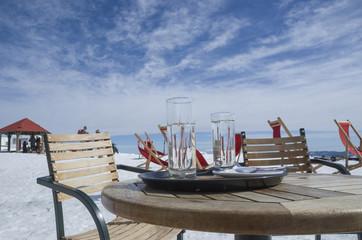 table chairs glasses in Vasilitsa ski center, Greece