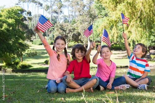 Happy little friends waving american flag - 78770807