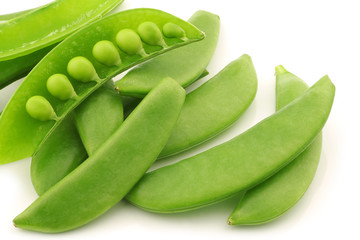 bunch of sugar snaps with one opened pod with peas visible