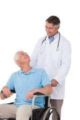 Doctor pushing senior patient in wheelchair