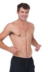 Fit shirtless man smiling at camera