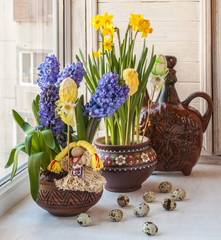 Hyacinths in a pot Ukrainian and Ukrainian folk toy.