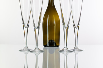 Four  champagne glasses on a glass table