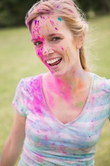 Young woman having fun with powder paint