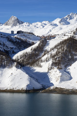Tignes village in winter with lake