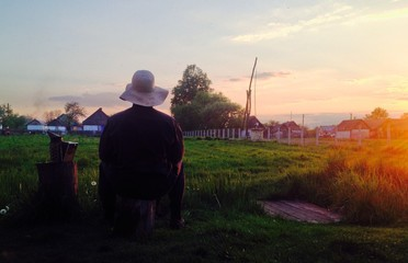 Man enjoying summer sunset in countryside