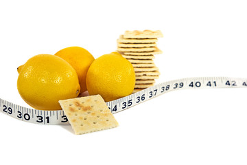 lemons and soda cracker with tape measure