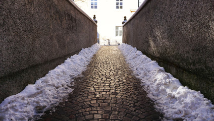 walkway with snow in old town
