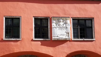 old rose color facade and sculpture