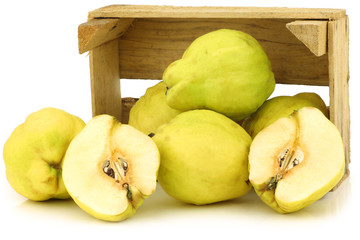 "fresh quince fruits ""Cydonia oblonga"" in a wooden crate"