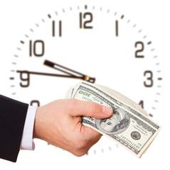 Businessman holding cash dollars in hands
