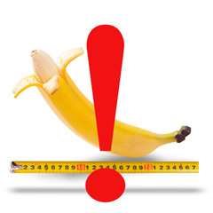 Large banana and measuring tape as image of man's penis