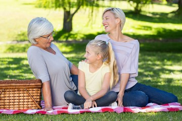 Happy blonde with her daughter and mother