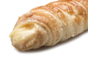 Italian cannoli filled with egg custard on white background
