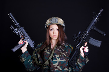 Portrait of a military woman with two guns