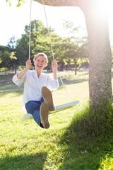 Happy blonde swing