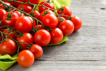 Cherry tomatoes on wood background