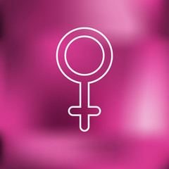 Female gender symbol. Blurred background