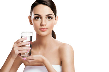 Young beautiful woman with glass of clear water