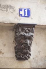Francia,Normandia,Caen, scultura su muro.