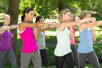 Fitness group working out in park
