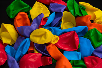 Balloons rainbow colors on a black background