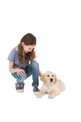 Crouching little girl next dog