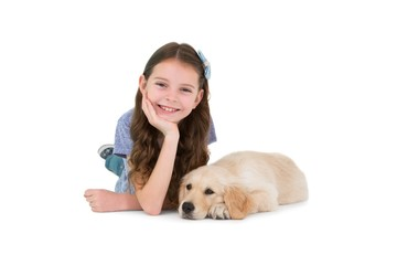 Lying little girl with a dog