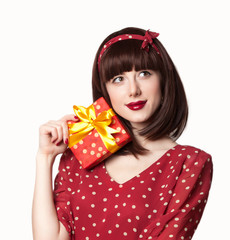 girl in red dress with gift box