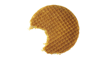 Dutch waffle called a stroopwafel with a bite missing