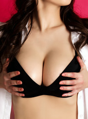 Busty woman touches her breasts