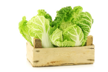 chinese cabbage in a wooden crate on a white background