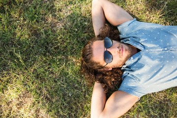 Young man lying down in the park