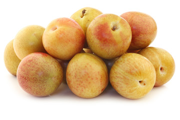 Fresh pluots (Prunus salicina x armeniaca) on a white background