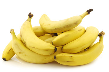 a bunch of fresh bananas on a white background