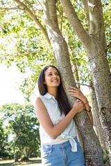 Pretty brunette smiling in park