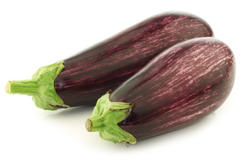 striped aubergines on a white background