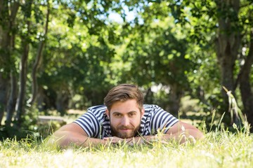 Hipster lying on the grass in the park