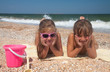 Two adorable toddler girl  on sand beach