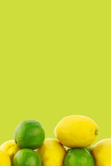 fresh lime fruit and some lemons on a green background