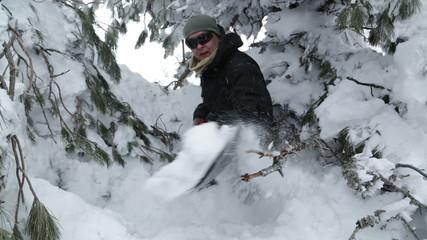 young man shoveling snow