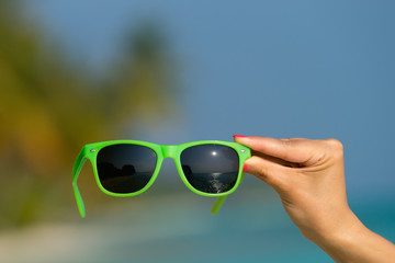 Picture of sunglasses on the tropical beach, vacation. Traveller