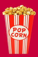 caramel popcorn in a decorative paper popcorn cup