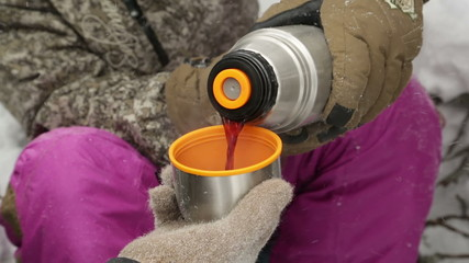 Hand filling cup with hot drink