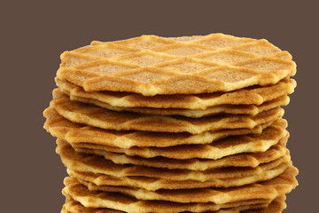 stacked Dutch waffles on a brown background